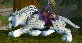 Rênes de sabre-de-givre tacheté - Monture World of Warcraft