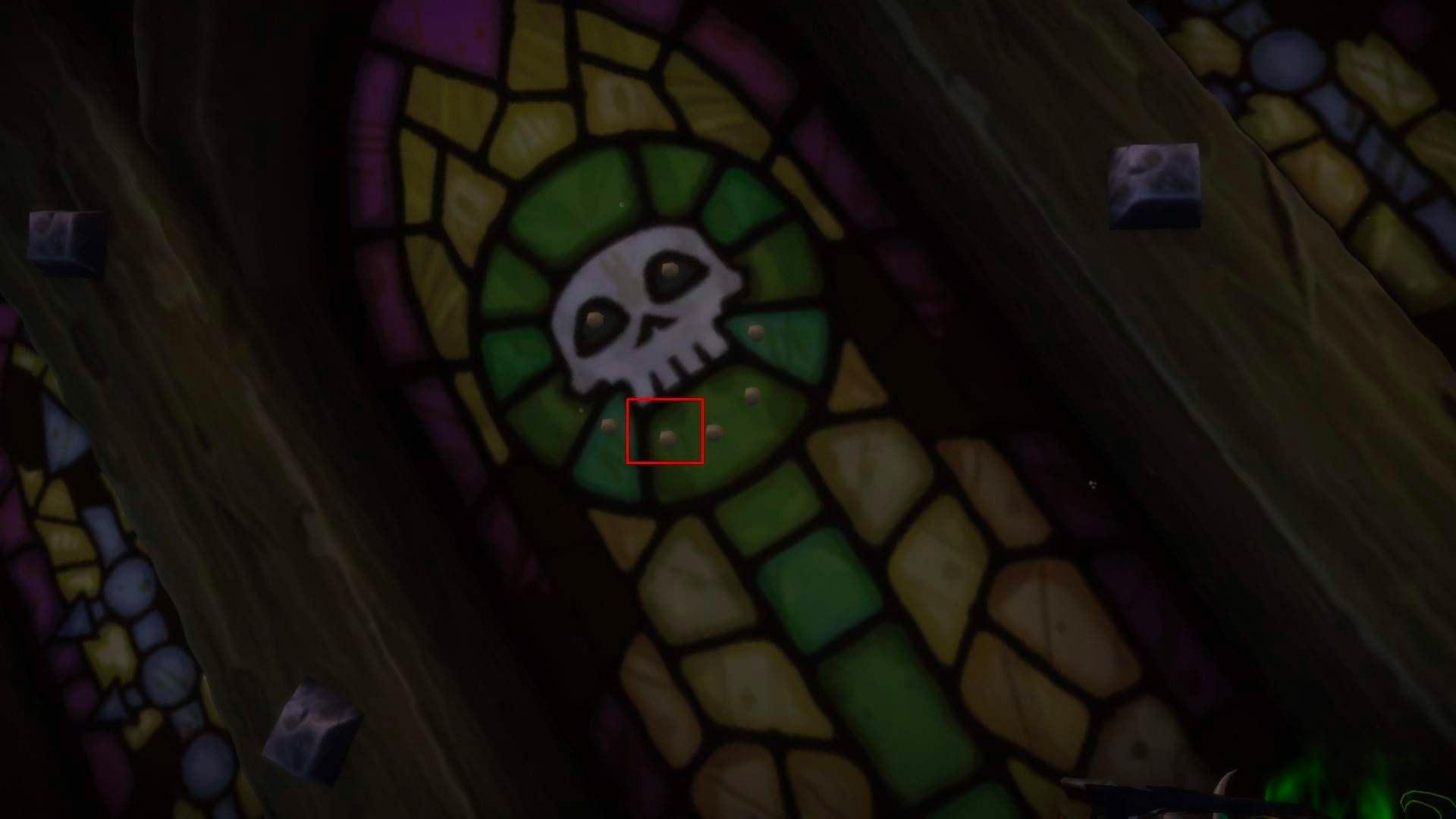 Le caillou se situe sur le vitrail derrière le bateau
